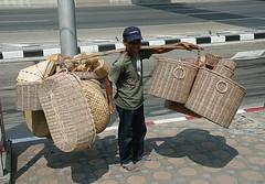 basket vendor (the foreign photographer - ) Tags: road man mobile canon thailand kiss bangkok board baskets vendor shoulder chaengwattana bangkhen 400d