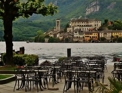 dining with a view (SM Tham) Tags: italy lake mountains tree church water buildings island waterfront chairs basilica monastery tables lakeorta italianlakes isolasangiulio ortasangiulio