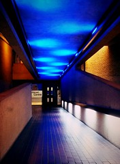 Blue-Roofed Corridor (John of Witney) Tags: blue london vanishingpoint interior corridor barbicancentre