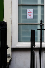 Woman's Prayer Room sign pointing down staircase (Ian Redding) Tags: uk red london english sign sex female worship muslim islam traditional religion mosque arabic direction british tradition residential printed gender islamic separation controversial segregation sharia womansprayerroom