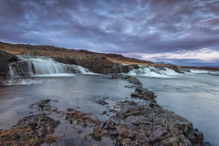 Waterfalls at Sunrise (JSP92) Tags: cloud west grass sunrise dawn is waterfall iceland rocks long exposure moody purple you le hank foreground