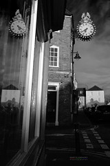 Wotton Time (gregoryphoto150) Tags: street uk urban blackandwhite reflection clock monochrome shop early high time outdoor front gloucestershire fancy wottonunderedge