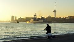 The lonely trumpet player (R. Engelsman) Tags: music boot boat rotterdam marine ship ships navy trumpet muziek goldenhour euromast schip trompet