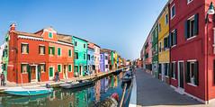 Living in a Rainbow (MaxSkyMax) Tags: blue venice houses windows sky italy water canon reflections boats canal rainbow italia doors colours perspective clear venezia burano