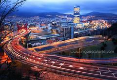 Amazing Bilbao cityscape at sunset (Iigo Escalante) Tags: street city travel light sunset sky urban espaa building museum architecture night river dawn lights luces spain san europe long exposure country ciudad bilbao museo bizkaia basque vasco ria euskadi vizcaya pais iberdrola guggemheim mames