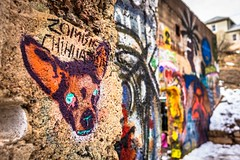 An entire wall devoted to street art; Bisbee, AZ.