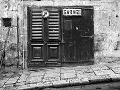 Garage (albireo 2006) Tags: door blackandwhite bw blackwhite garage noparking malta pb nb bn valletta blackandwhitephotos blackwhitephotos