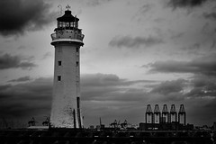 Lighthouse and docks (another_scotsman) Tags: lighthouse seascape river landscape mersey perchrock
