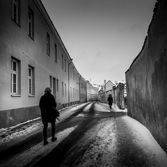 Winter in town (Edgaras Vaicikevicius) Tags: road street city winter people bw white house snow black building monochrome architecture women streetphotography monochrom bnw 2016 edgarasvaicikevicius