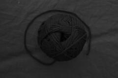 Somber Yarn (Miller A Mitchell) Tags: black wool thread monochrome field dark focus gloomy framed center monotone yarn trail frame material subject gloom shallow framing fleece somber wrinkles wrinkle depth centered specks flece