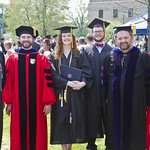 Professors and students at Commencement.