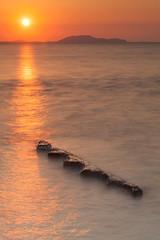 Sunrise at Chanthaburi Sea (baddoguy) Tags: sun seascape vertical thailand outdoors photography horizon tranquility nopeople copyspace dramaticsky tranquilscene partof unusualangle orangecolor colorimage beautyinnature goldcolored focusonforeground horizonoverwater sunrisedawn rockobject