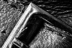 18/365 (theaftergloweffect) Tags: old light blackandwhite bw detail macro art texture motif monochrome leather metal closeup vintage 50mm grey gris blackwhite nikon focus pattern shadows skin boots noiretblanc lumire decay indoor nb used boucle inside nikkor shining peau vieux bottes intrieur ombres cuir brillant minimalisme us macromondays bukkle