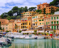 Motor boats and traditional houses in Puerto Soller, Mallorca, Spain (Travelbusy.com) Tags: travel blue sea summer vacation sky white house colour reflection building tourism water port landscape island coast harbor boat town fishing spain europe mediterranean village fishermen porto picturesque mallorca majorca soller colom balearic