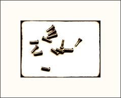 13 (Bob R.L. Evans) Tags: metal pattern asymmetrical sepiatone imperfect ipadphotography stilllifebolts