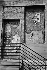 DR1-E005 (David Swift Photography Thanks for 15 million view) Tags: streetart abandoned film philadelphia 35mm urbandecay steps storefronts ilfordxp2 railings posterart northphilly yashicat4 davidswiftphotography