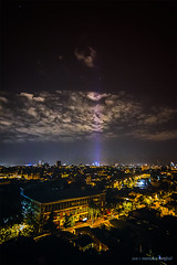 lighting the skies (Romulus Anghel) Tags: city travel blue urban rooftop colors beautiful beauty night clouds canon buildings cityscape nightscape romania bucharest bucuresti nori 70d