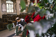 Red roses in church (Anna_L.) Tags: red roses bradford cathedral bokeh pray