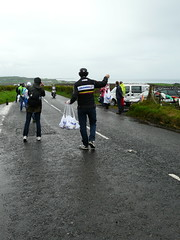 Displaying The Wares (mdavidford) Tags: road bag cycling waiting colombia delivery dangle hang bushmills stage2 supply giroditalia feedzone handingout musette soigneur whiteparkroad