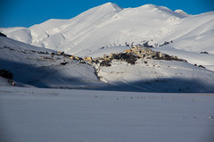 Winter in Castelluccio (emanuelezallocco) Tags: road blue winter light shadow sky people italy panorama parco cloud moon house mountain snow cold tree history ice nature night plane trekking river walking stars landscape photography grande photo europe alone village wind board confine luna hills silence cielo valley hour neve piccolo inverno borgo freddo marche sul paesaggio umbria nera lentils castelsantangelo norcia silenzio castelluccio nazionale streat nessuno pian sibillini perduto allaperto lenticchie visso