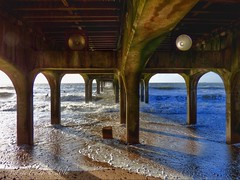Under the Pier (Belinda Fewings (2.5 million views. Thank You)) Tags: street city winter light sun colour building beach wet beautiful beauty architecture out outside flow outdoors seaside surf waves shadows arty artistic bokeh horizon sunday creative arches surfing depthoffield dorset colourful rough underneath lovely february imogen orbs beneath wavy bournemouth ebb the boscombe boscombepier surfy beautify southcoastofengland panasoniclumixdmc pbwa creativeartphotograhy belindafewings stormimogen