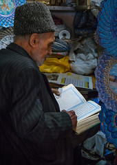 old man reading koran in his shop, Isfahan Province, isfahan, Iran (Eric Lafforgue) Tags: travel people man men tourism senior vertical religious photography reading asia day sitting iran market muslim faith religion persia business indoors human souk merchandise bazaar dailylife orient adults esfahan abundance bazar adultsonly oneperson islamic isfahan middleeastern koran menonly seniorman ispahan 50sadult إيران onemanonly waistup иран 1people イラン irão isfahanprovince 伊朗 colourpicture 이란 hispahan irandsc08431