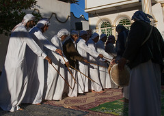 men dressed in white dancing with sticks during a wedding ceremony, Hormozgan, Bandar-e Kong, Iran (Eric Lafforgue) Tags: wedding people music men horizontal outdoors togetherness dance clothing sticks asia dancers dancing iran muslim islam traditional ceremony culture traditions marriage persia folklore dancer east kong celebration entertainment arab cheerful custom eastern groupofpeople cultures adultsonly cultural islamic customs ethnicity middleeastern persiangulf traditionalculture sunni menonly traditionalclothing culturally hormozgan  bandari  5people  iro seniormen straitofhormuz  colourpicture bandarekong  irandsc05004