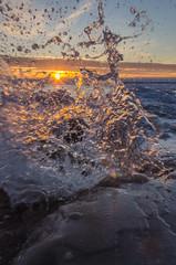 Orange Crush (Aaron Springer) Tags: winter sunset ice nature landscape outdoor michigan lakemichigan sunburst february starburst breakingwave frankfort northernmichigan iceshelf thegreatlakes