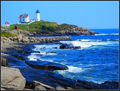 Nubble Light - Photo by STEVEN CHATEAUNEUF - August 27, 2014 (snc145) Tags: nubblelight beach maine summer seasons lighthouse cliffs rocks ocean sky nature scenery waves vacation photo august272014 stevenchateauneuf blue gray green red white seascape flag flagpole fence houses unedited flickrunitedaward autofocus thisphotorocks