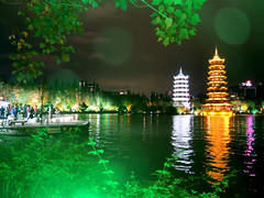 Pagodas (MelindaChan ^..^) Tags: china light reflection tree night pagoda colorful riverside guilin chinese mel melinda 漓江 lijiang guangxi 桂林 廣西 chanmelmel melindachan