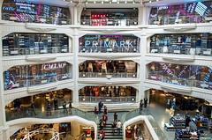 Consumidores en accin... (Leo ) Tags: madrid color luz luces arquitectura gente edificio tienda consumismo sociedad granva comercio escena primark