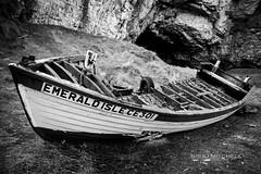 Boat Wreck (TimeTraveller37) Tags: old ireland sea cold wet contrast canon mono boat blackwhite rocks photographer perspective windy nopeople monochromatic cliffs caves northernireland wreck emeraldisle muddy whiteandblack ballintoy coantrim 1755mm gameofthrones pyke ballintoyharbour canon7d theongreyjoy ironislands