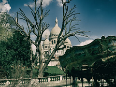 Sacre Coeur 2 (marcritchie) Tags: city sky paris france tree primavera clouds spring cathedral fairground dramatic carousel olympus montmartre sacrecoeur omd marcritchie