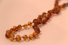 amber teething necklace for babys for Macro monday twist (Dany Morgens) Tags: baby amber necklace twist teething hmm bernstein zahnen macromondays bernsteinkette macromondaytwist