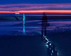 Crosby beach light painting (SiKenyonImages) Tags: sunset lightpainting liverpool dark illumination ironman torch merseyside anotherplace crosbybeach