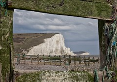 Fenced in (sussexscorpio) Tags: wood longexposure sea sky green beach water clouds canon fence sussex coast outdoor framed tide pebbles rope cliffs naturereserve frame lowtide algae nationaltrust sevensisters eastsussex seaford groynes seafordhead sussexwildlifetrust canon60d woodengroynes southdownsnationalparkauthority sussexheritagecoast sussexdownsareaofoutstandingnationalbeauty