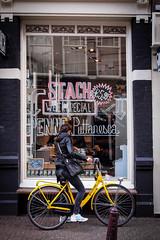 (Kazze) Tags: street city travel woman window colors amsterdam bike shop wall donna colore xxx vetrina cornershop olanda pasticceria 2014 scritte puttanesca graggiti