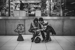 2/3 (realnasty) Tags: street boy people urban bw woman man girl monochrome station three chair candid seat pair poland olympus smartphone katowice waitingroom omd m43 mft microfourthirds