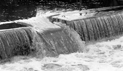Another Weir on the Brock Tri-X TD-201 (Man with Red Eyes) Tags: slr monochrome analog blackwhite kodak trix weir stopped nikonf6 f6 fixer silverhalide nikkor105mmf25 riverbrock v850 td201 anchelltroop a3minsb3mins continuousagitation