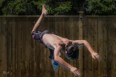 Wild Man Dive (rakelgoiri) Tags: wood summer portrait people ontario pool fence jump backyard action dive waterloo teenager dip actionphotography rakelgoiri