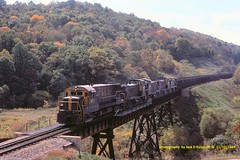 PLE 2818, Rogersville, PA. 11-10-1984 (jackdk) Tags: railroad trestle bridge train railway coal ge mga monongahela emd coaltrain ple rogersville mp15dc coaldrag mp15 pittsburghandlakeerie gelocomotive emdmp15dc emdmp15 rogersvillepa monongahelarailway 428b geu28b