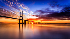 The colors of a new day (One_Penny) Tags: morning travel bridge sky sun color colour portugal water rio architecture clouds sunrise canon reflections river photography europe lisboa lisbon ponte lissabon tajo canonef1740mmf4lusm vascodagama iberianpeninsula pontevascodagama riotejo iberischehalbinsel canon6d widgeangle
