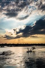 Perfect Day (TalesOfAldebaran) Tags: sunset summer silhouette vertical clouds river landscape boat fishing fisherman fishermen serbia joy upright waterscape srbija sunthroughclouds reka zalazak drina pecanje pejzaz ribolovci