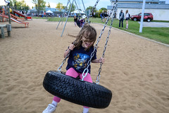 Rose's First Tire Swing Ride (Vegan Butterfly) Tags: park city blue party urban music playing cute public girl playground festival fun outside person kid vegan edmonton child play ride outdoor adorable tire swing event alberta homeschool quill homeschooling