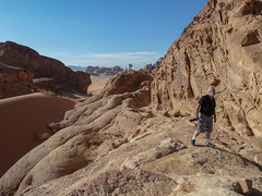 Inspecting the desert. Wadi Rum (Igor Sorokin) Tags: camera travel people panorama mountains composition landscape lumix sand rocks desert hiking wadirum scenic hike tourists panasonic jordan distance travelers distant