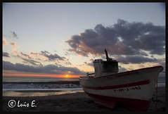 Atardecer en Las Salinas..Cabo de Gata (Almeria) (luensalo) Tags: atardecer mar barcos playa salinas arena cielo nubes puestadesol cabodegata canon18200mm canon550d