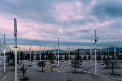 Light and Steel (sotiris_tzatzakis) Tags: trees light sunset sky color clouds nikon parking columns dramatic athens greece poles oaka d5100