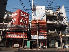 Cables (Feldore) Tags: street thailand wiring bangkok olympus cables wires shops poles telegraph tangle mchugh cabling tangles em1 1240mm feldore