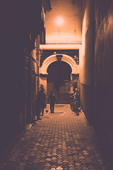 At Night (Simone Della Fornace) Tags: street city light people urban playing silhouette architecture kids night zeiss football alley nightshot soccer sony streetphotography morocco marrakech streetphoto matte a7rii