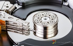 An Open Computer Hard Drive - Microstock Photography (grobler.inus) Tags: backup white speed silver computer photography reading pc technology spin storage equipment data harddrive repairing write encryption magnet magentic ishootraw fotoinusgrobler